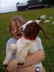 child with a goat