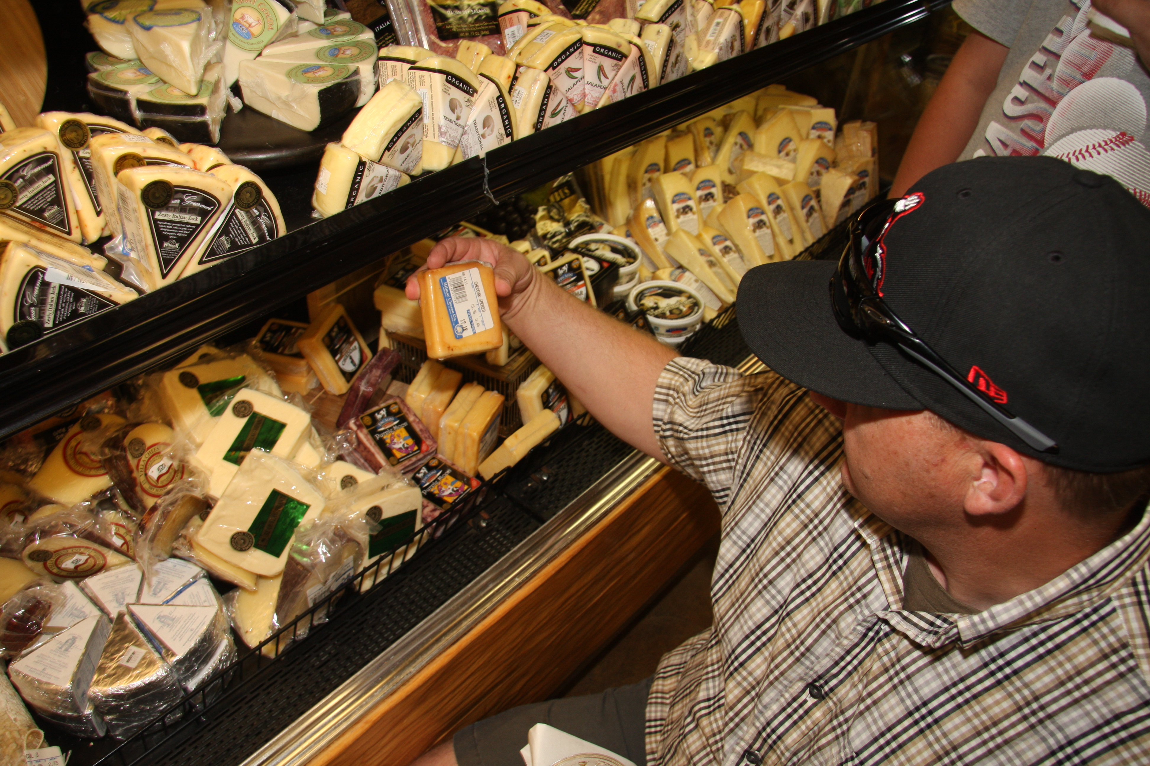 Dairy farmer Ray Prock selects good cheeses