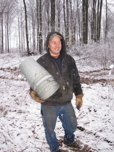 Jerry with an arm full of buckets for maple sap