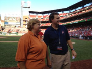 April Hemmes visits with a member of the Cardinals office