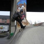 skater riding the top of the chute