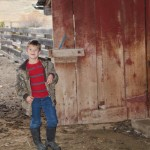 child at an old barn Kyle