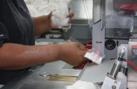scanning a barcode for cotton sample