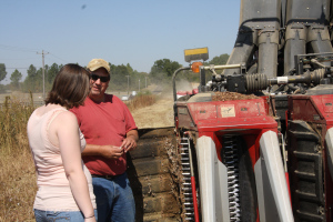 a cotton farmer tells a city girl how a picker works
