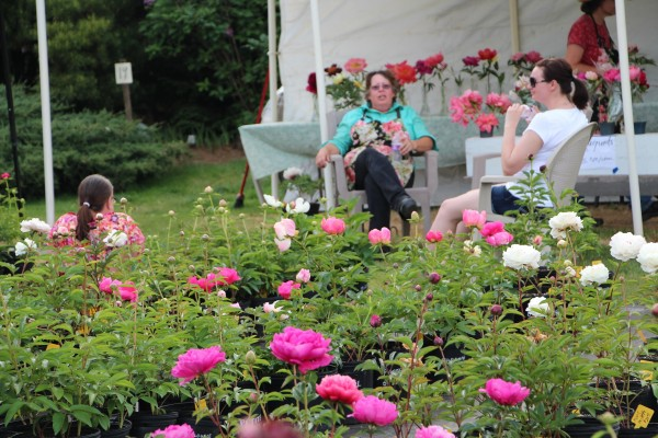 flower farmer Therese resting with friends after a long day
